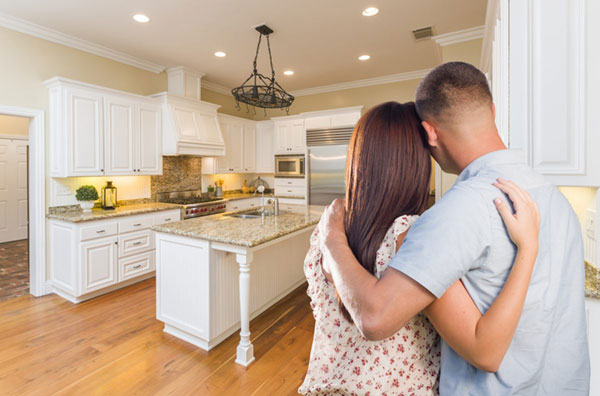 Couple looking at new kitchen